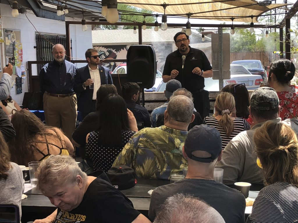 At the Coronado in Phoenix's summer heat are Congressman Gallego and Maricopa County Recorder Adrian Fontes holding a town hall meeting.